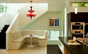 corner dining room with broken white sofa playing your