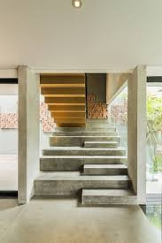 home interior design steps wood and concrete contrasting or complimenting materials