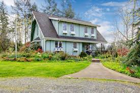 big farmhouse big farmhouse with beautiful flowerbed concrete walkway and