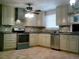 painting above kitchen cabinets mahogany wood sage green shaker door soffit above kitchen cabinets