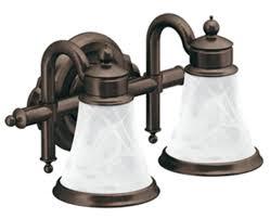oil rubbed bronze bathroom light fixtures over medicine cabinet