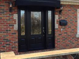 exterior black wooden door with frosted glass insert narrow window