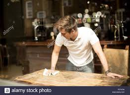 Cleaning Table Stock Images Royalty by Young Man Cleaning Table In Public House Stock Photo Royalty Free