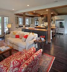 modern farmhouse living room with bright pops of red dark wood