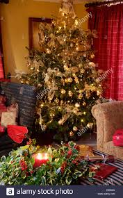 gold baubles and decorations on tree in cottage living