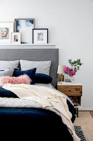 accent ls for bedroom apartment bedroom navy and grey with wood accent the everygirl