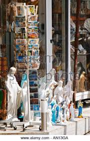 rosary shop a shop with souvenirs for pilgrims with things for sale madonna