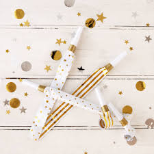 new years party blowers gold and white party blowers by postbox party notonthehighstreet