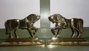 pair of brass shire ornaments doorstops haylett antiques