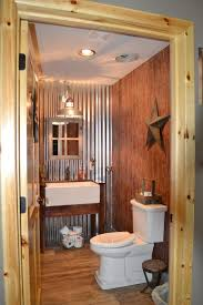 perfectly executed barn style bathroom decor galvanized