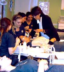 esthetics students in training at the dermal science international