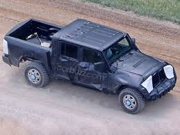 jeep truck spy photos our spy photographers just proved the jeep pickup is more than a