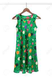 bright green funky dress on a wooden hanger isolated on white