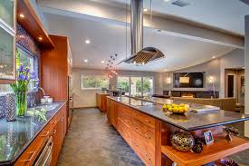 open kitchen with island island cooktops central to an open kitchen and dining space jdr