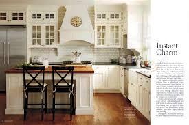 striking antique butcher block kitchen island with black wrought