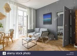 scandi style gray living room with balcony door stock photo