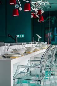 kitchen transparent armchairs also tousled branch pendant lamps