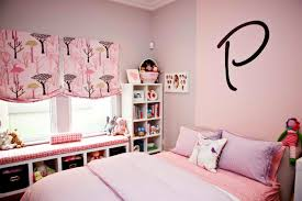 pink and purple wall theme added by white wooden shelves on the