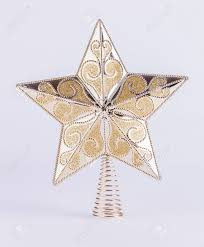 patterned gold star on spring christmas tree topper decoration