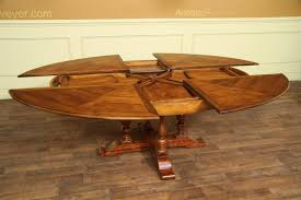 round dining room tables with self storing leaves 78 94 oval to oval solid walnut jupe dining table