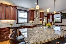 light cherry kitchen cabinets and granite viscont white granite countertops with cherry cabinets