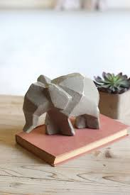 594 best elephant art images on pinterest elephant art elephant this cubism inspired ceramic elephant is finished with an understated taupe glaze and can be displayed as accent piece on its own or with its safari