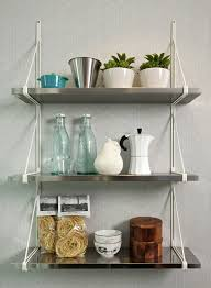 three rectangle stainless steel wall mounted shelves with white