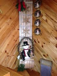 old toboggan decorated for the season country christmas