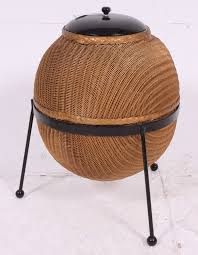 a lloyd loom sputnik wicker linen basket designed by geoffrey