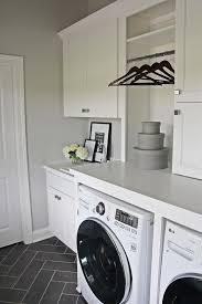 laundry room floor cabinets white laundry room with gray herringbone floor laundry rooms