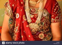 wearing traditional gold jewellery in neck rajasthan india