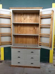 a painted plank 2 door 6 drawer housekeeping larder cupboard