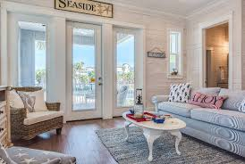 Coastal Cottage Living Rooms by Beach Cottage With Whitewashed Plank Walls Home Bunch U2013 Interior