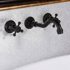 Black Bathroom Sink Faucet by Black Waterfall Two Knob Handle Wall Mounted Bathroom Sink Faucet