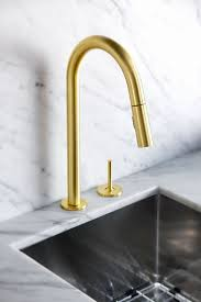 brass faucets kitchen golden details gold is chic and modern brass fixtures to upgrate