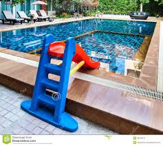 beautiful swimming pool with tot slide royalty free stock images
