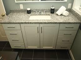 semi custom vanity white shaker doors with granite top
