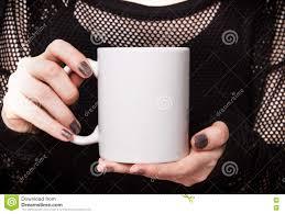 halloween coffee mug in black dress is holding white mug mockup for halloween