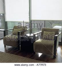 Contemporary Armchairs Pair Of Contemporary Armchairs In A Light Living Room With White
