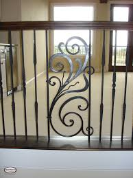 nice and appealing wrought iron spiral staircase mixing wood with iron balustrades wrought iron panels used as a