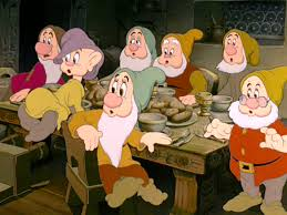 snow white prepares thanksgiving dinner while the seven dwarfs