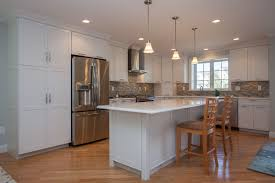 l shaped white kraftmaid kitchen with island this kitchen