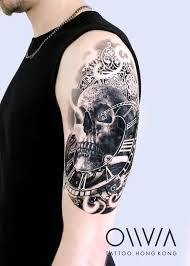 Skull Arm - black and grey skull on the left arm and shoulder