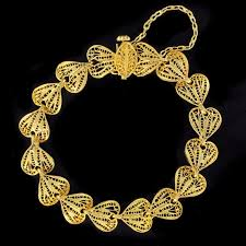 chain links bracelet images 1960s filigree hearts design 18 karat yellow gold chain bracelet jpg