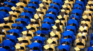 blue cap and gown ged graduates persistence earns them cap and gown at 64 years