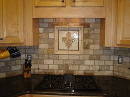 kitchen with glass backsplash teal tiles glacier faucet sink soap