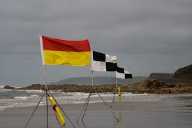 Uk Beach Flags Widemouth Sand Photo