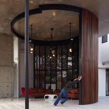 church glass doors curved and stacking louvered glass doors surround room in voila house