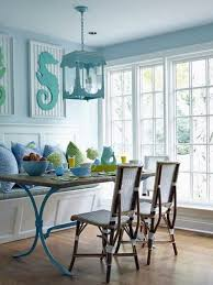 eclectic dining room with built in bench seating u0026 pendant light
