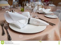 set up dinner room in the hotel folded napkin laid on plate stock